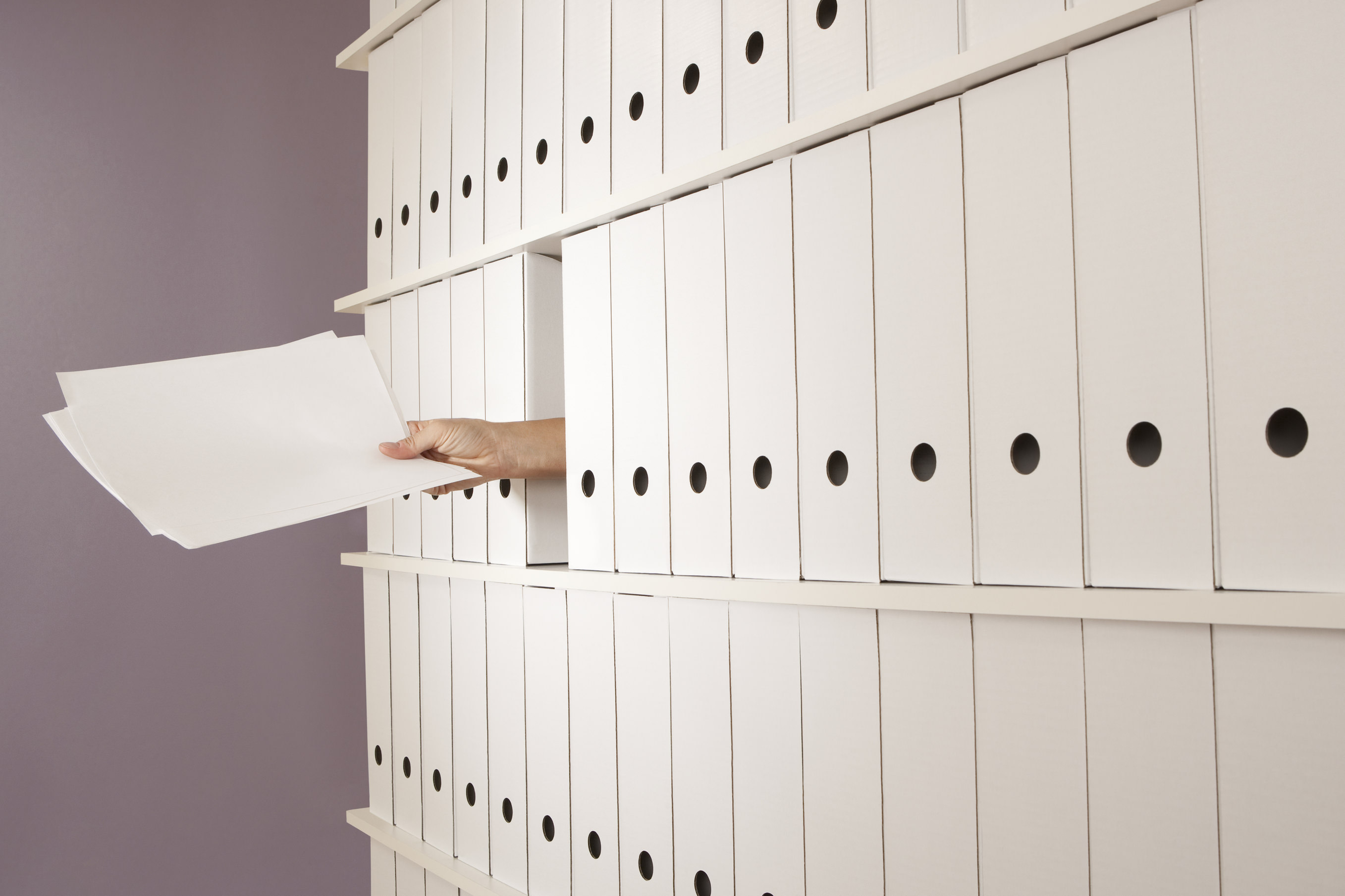 A helping hand appears through many folders and files holding the paperwork you are looking for.